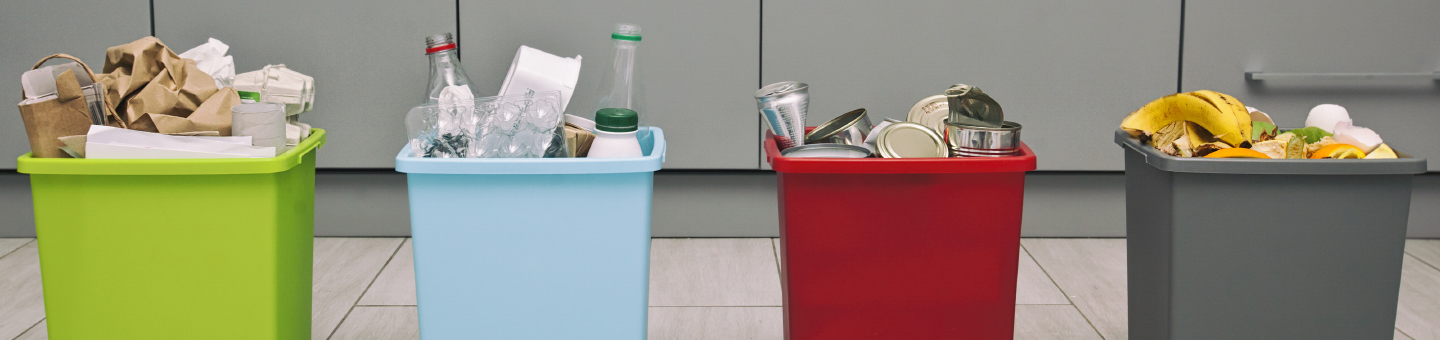 Colourful bins with different types of waste